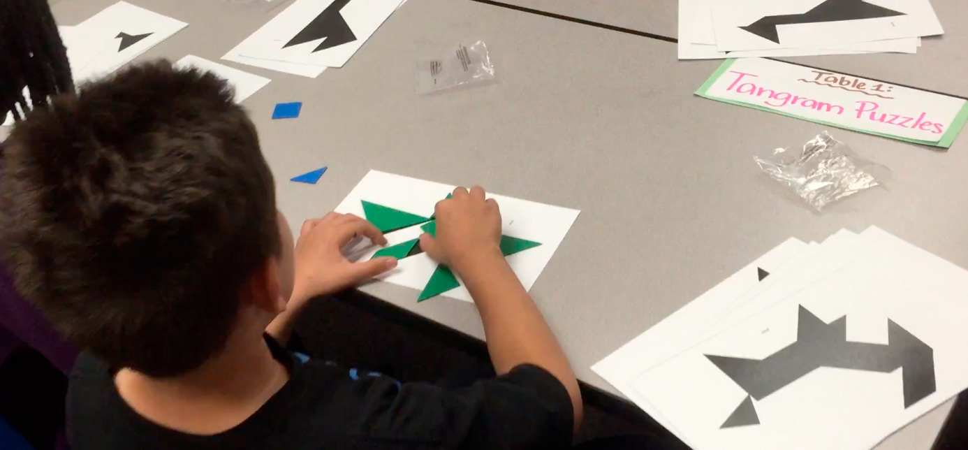 Photo of a student working on tangrams